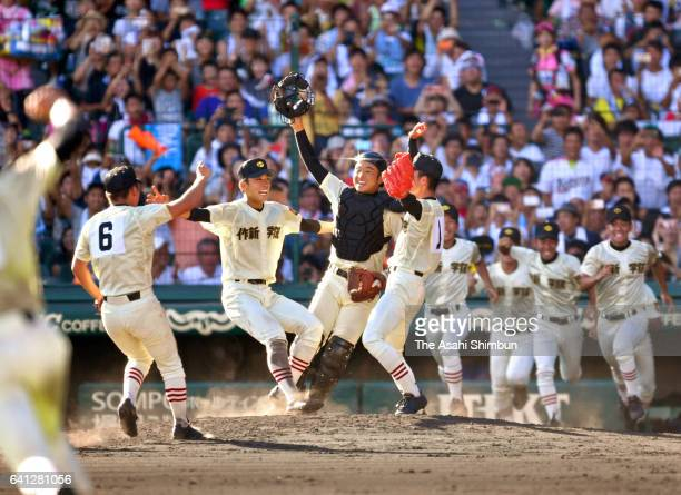 Sakushin Gakuin players celebrate winning the 98th National High School Baseball Championship final against Hokkai at Hanshin Koshien Stadium on...