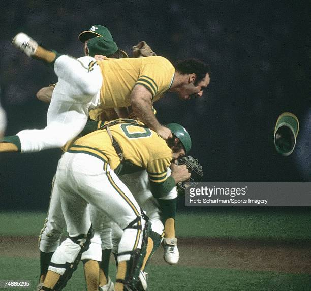 Sal Bando of the Oakland Athletics jumps on top of teammates after defeating the Los Angeles Dodgers in Game 5 of the World Series on October 17 1974...