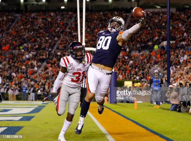 Sal Cannella of the Auburn Tigers fails to pull in this touchdown reception against Jaylon Jones of the Mississippi Rebels in the first half at...