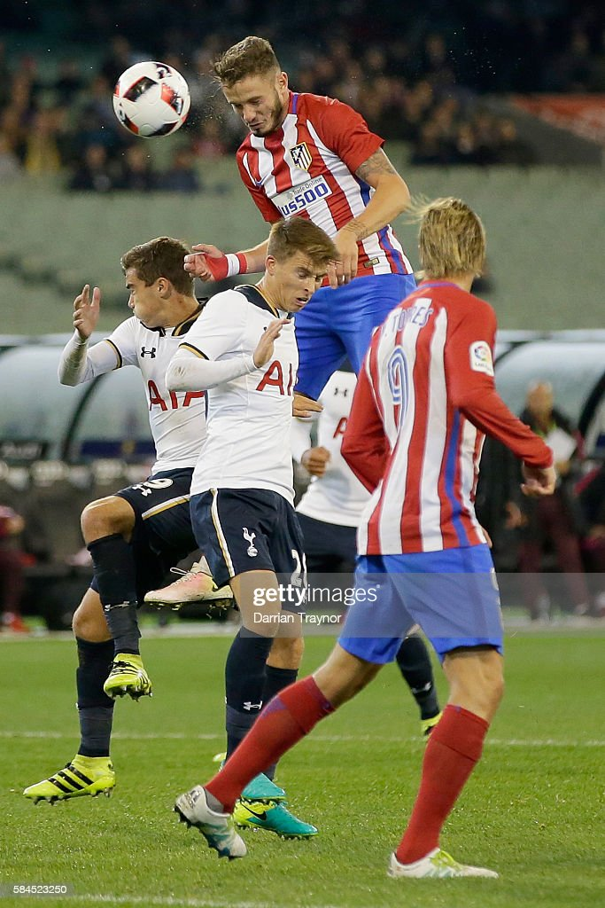 Sal guez of Atletico Madrid jumps above his opponent to head the ball towards goal during 2016 International Champions Cup Australia match between Tottenham Hotspur and Atletico de Madrid at Melbourne Cricket Ground on July 29, 2016 in Melbourne, Australia.