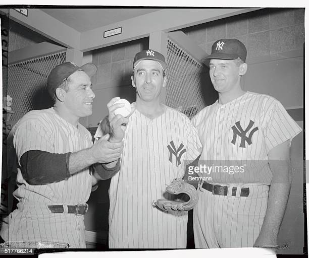 Sal Maglie is shown as he donned a Yankee uniform today after being traded from the Brooklyn Dodgers At left is Yogi Berra star catcher for the...