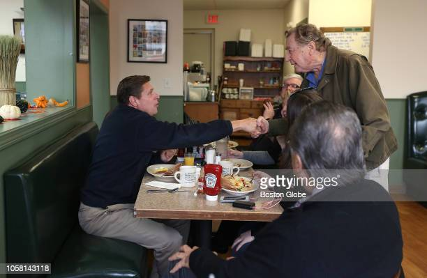 Sal Rizzo of Quincy shakes hands with Republican US Senate candidate Geoff Diehl at McKay's Breakfast Lunch in Quincy MA on Nov 5 2018