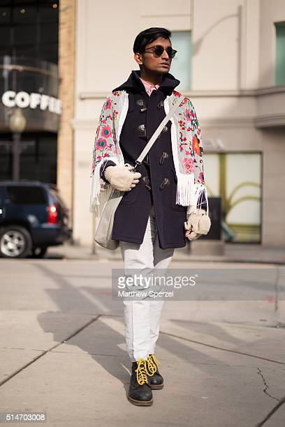Sal Salam is seen on Oak Street wearing JCrew light grey pants and glasses navy wool Brooks Brothers coat vintage silk and velvet floral cape...