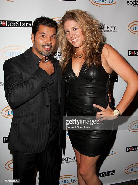 Sal Velez Jr and Lizza Monet Morales attend Get Lucky For Lupus LA at Peterson Automotive Museum on September 12 2013 in Los Angeles California