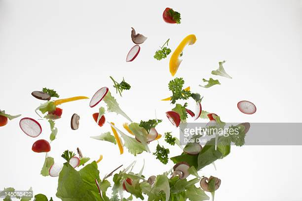 salad against a white background - throwing stock pictures, royalty-free photos & images