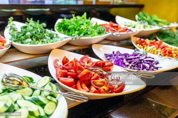salad bar with fresh vegetables in hotel buffet - buffet stock pictures, royalty-free photos & images