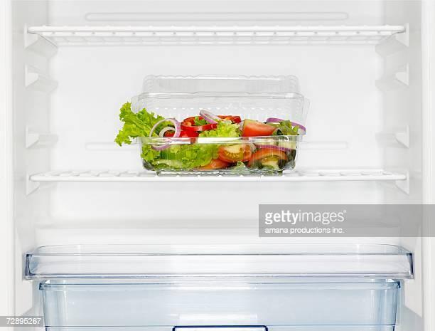 Salad box in fridge (close-up)