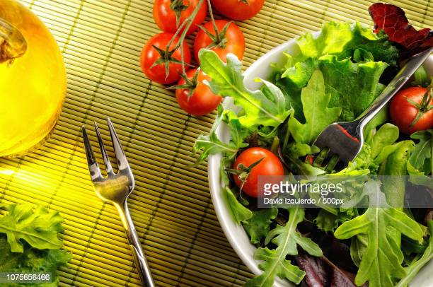 salad in a bowl on bamboo tablecloth top view