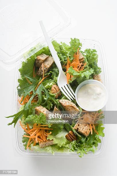 Salad leaves with carrots, croutons & sour cream dressing