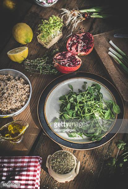 Salad leaves with pomegranate, manna croup, spring onion, lemon and herbs