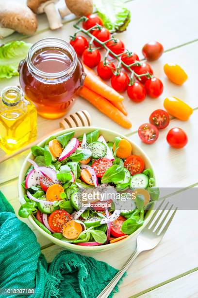 salad mix bowl shot from above on light green picnic table - southern europe stock pictures, royalty-free photos & images