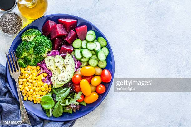 salad mix plate shot from above on light gray marble table - vegan food stock photos and pictures