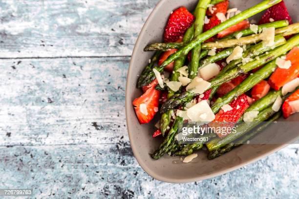 Salad of green asparagus, strawberries and parmesan