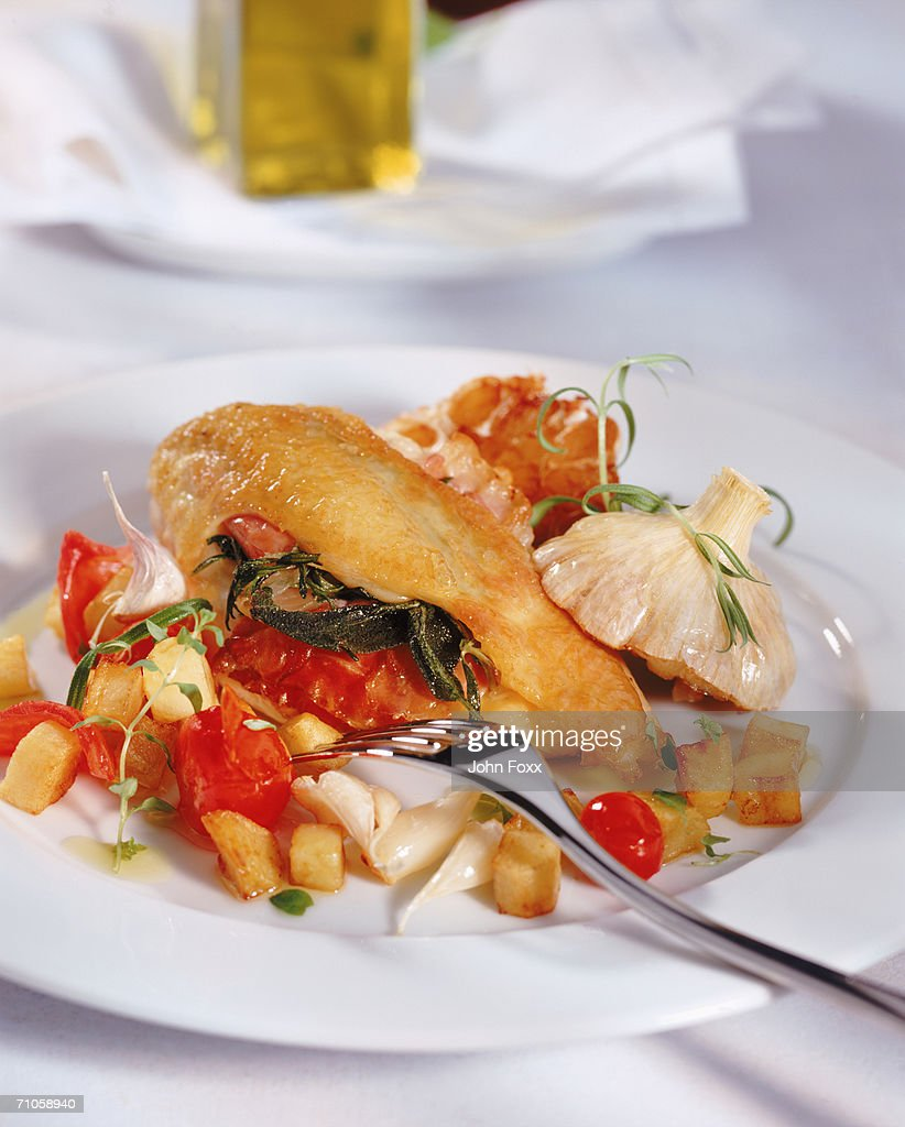 Salad on plate with fork, close-up : Stock Photo
