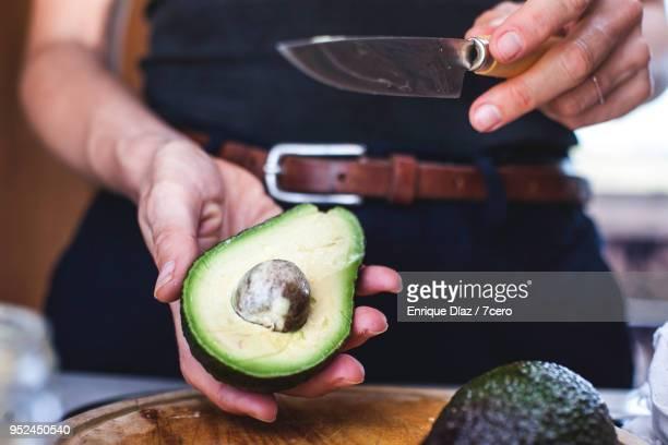 salad preparation: slicing avocado 1 - avocado stock pictures, royalty-free photos & images