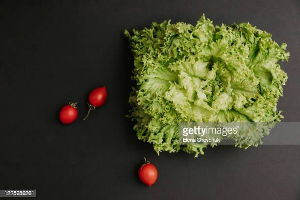 salad, tomatoes isolated on black background.food supplies crisis food stock for quarantine.food delivery, donation, coronavirus.tape measure. - odessa crisis stock pictures, royalty-free photos & images