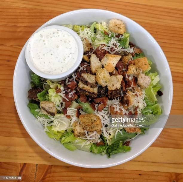salad with croutons, bacon, cheese, and ranch dressing - salad dressing stock pictures, royalty-free photos & images