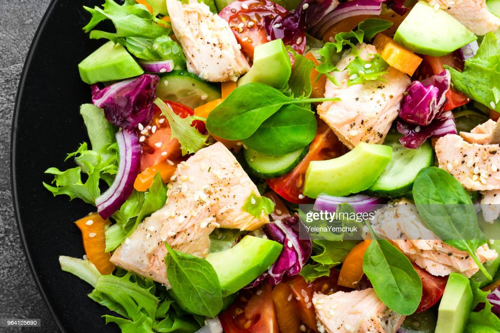 Salad with fish. Fresh vegetable salad with salmon fish fillet. Fish salad with salmon fillet and fresh vegetables on plate : Stock Photo