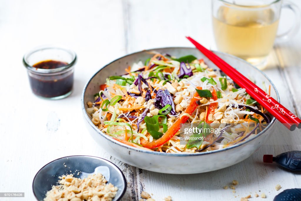 Salad with glas noodles, cabbage, carrots, bell peppers, spring onions, peanuts and hot thai dressing : Stock Photo