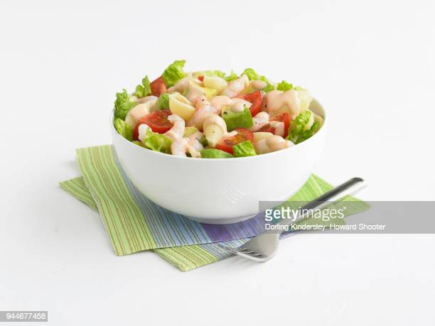 Salad with prawn, avocado, tomato and lettuce in bowl