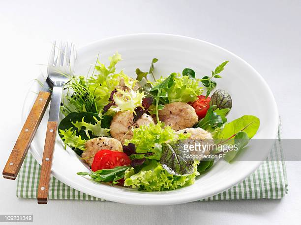 Salad with veal sweetbread in bowl, close-up