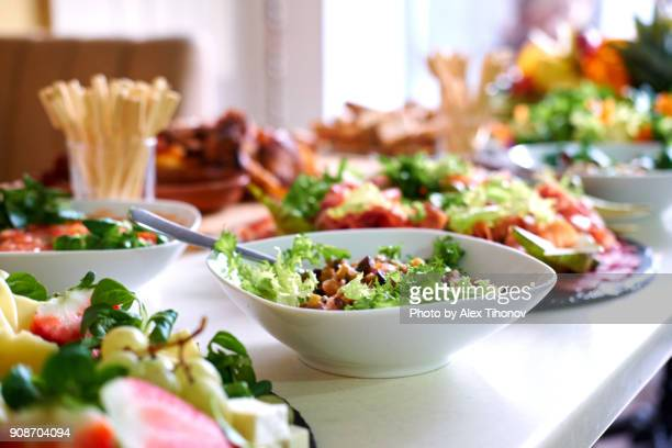 Salads and snacks on a table