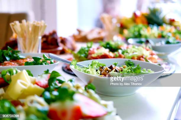 salads and snacks on a table - almoço imagens e fotografias de stock