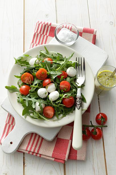 Salads: Arigula Salad with Cherry Tomatos, Mozzarella and Pesto