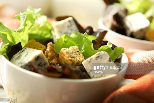 salads: blue cheese, walnuts and croutons - roquefort cheese stock photos and pictures