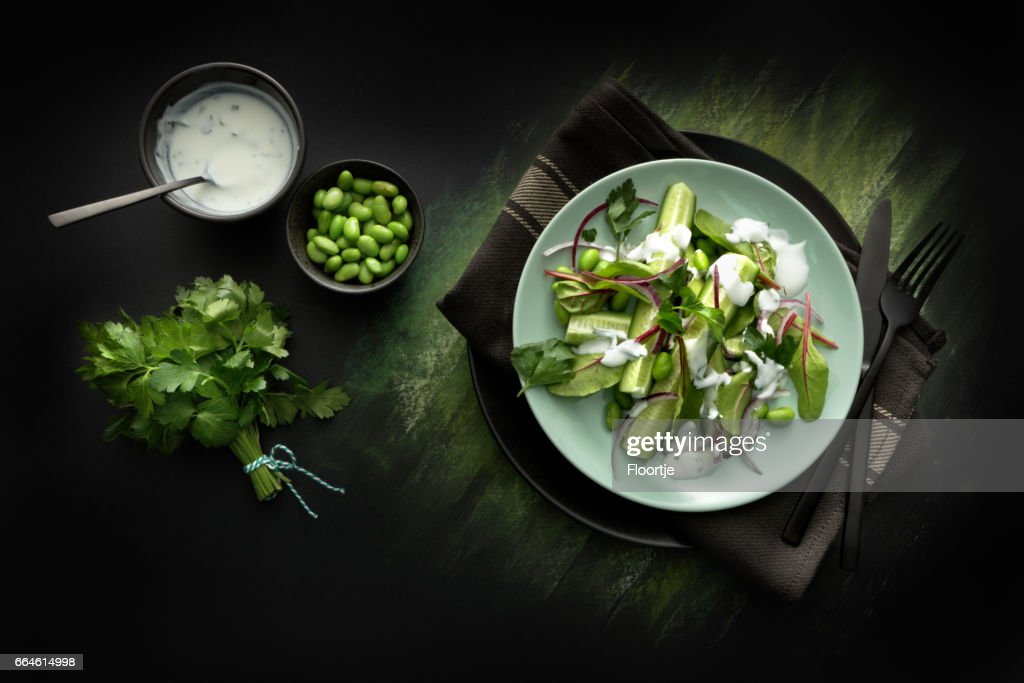 Salads: Salad with Cucumber, Lettuce, Soybeans, Parsley and Yoghurt Dressing : Stock Photo