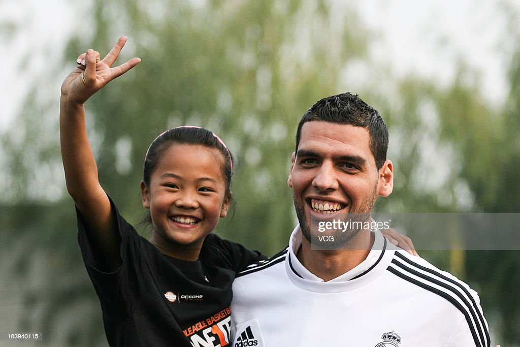 Salah Mejri of Real Madrid basketball team visits Hongshan Primary School on October 9, 2013 in Beijing, China.