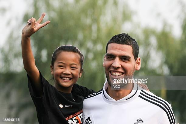 Salah Mejri of Real Madrid basketball team visits Hongshan Primary School on October 9, 2013 in Beijing, China.