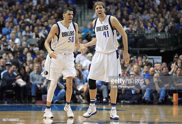 Salah Mejri of the Dallas Mavericks celebrates with Dirk Nowitzki of the Dallas Mavericks after scoring against the Brooklyn Nets in the second half...