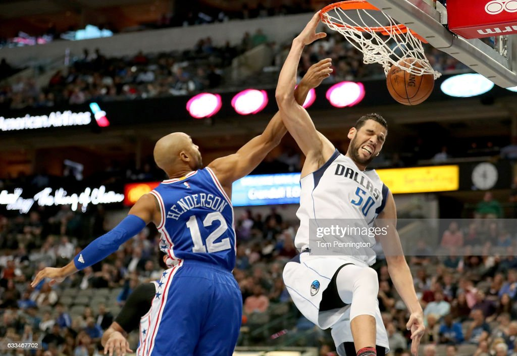 Salah Mejri #50 of the Dallas Mavericks dunks against Gerald Henderson #12 of the Philadelphia 76ers in the second half at American Airlines Center on February 1, 2017 in Dallas, Texas.
