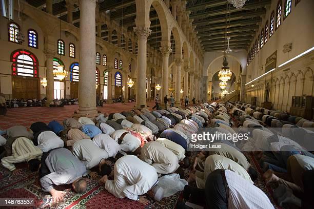 salah muslim prayer, umayyad mosque. - salah islamic prayer stock pictures, royalty-free photos & images