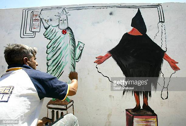 Salaheddin alSallat 30yearsold an Iraqi artist makes a wall painting depicting the prisoner abuse in Abu Ghraib prison on the main street of alSadr...