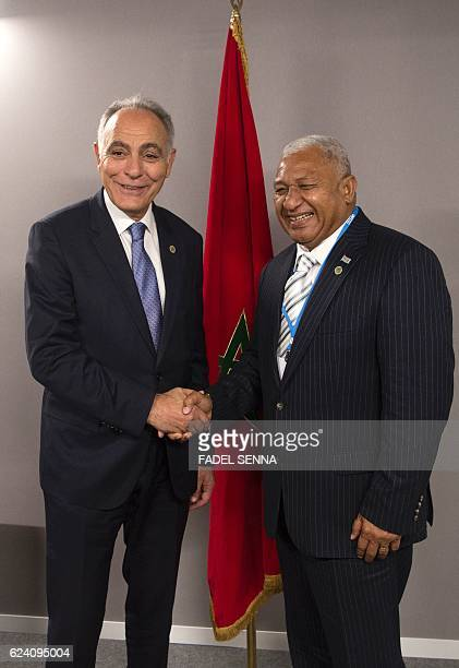 Salaheddine Mezouar the Moroccan minister of foreign affairs and the president of the COP22 shakes the hand of Frank Bainimarama Prime minister of...
