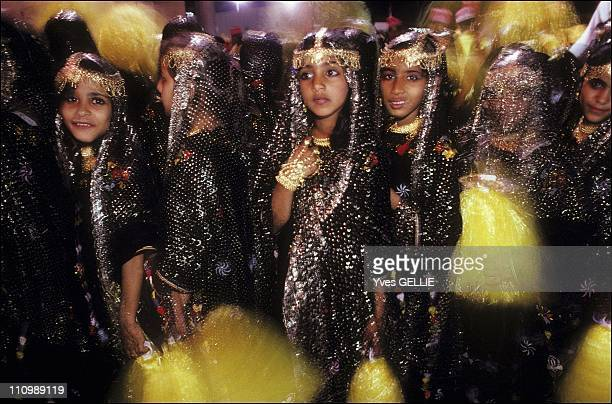 Salalah one of the last regions where women wear the bright 'Omani' veils and where the fronts of their dresses are embroidered with silver threads...
