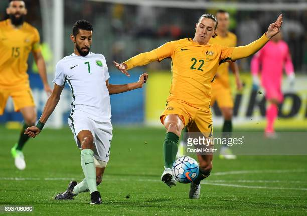 Salam Alfaraj of Saudi Arabia and Jackson Irvine of Australia compete for the ball during the 2018 FIFA World Cup Qualifier match between the...
