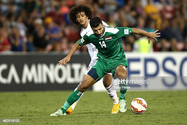 Salam Shakir of Iraq controls the ball in front of Omar Abdulrahman of the United Arab Emirates icontrols the during the Third Place 2015 Asian Cup...
