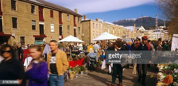 Salamanca markets with row of colonial era warehouses Hobart Tasmania Australia