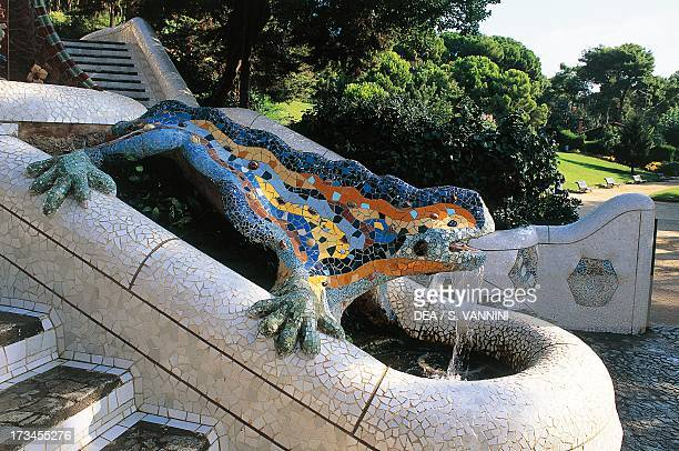 Salamander in maiolica enamel in the double staircase with a waterfall in the central entrance to Guell Park by Antoni Gaudi Barcelona Catalonia Spain