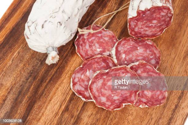 salami sausage on wooden board background - pepperoni stock photos and pictures