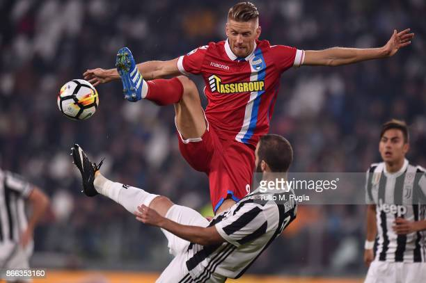 Salamon Bartosz of Spal and Gonzalo Higuain of Juventus compete for the ball during the Serie A match between Juventus and Spal on October 25 2017 in...