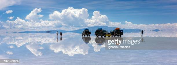 Salar de Uyuni (Salt Flats) 4x4 and people photographing the reflections, Mirror effect, Uyuni, Bolivia