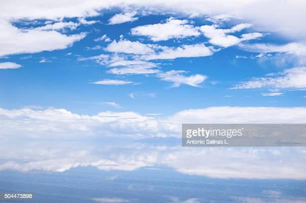 salar de uyuni in bolivia . sky reflected - ウユニ塩湖 ストックフォトと画像