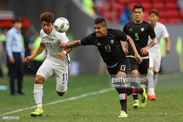 Salcedo Carlos of Mexico and Hwang Heechan of South Korea during the Group C match between Mexico v South Korea of the Rio 2016 Olympic Games at Mane...