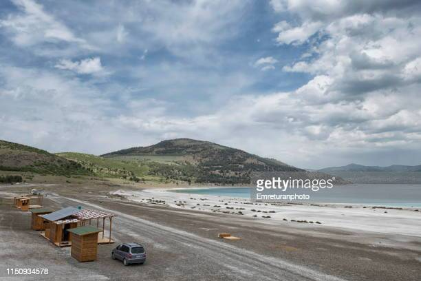 salda lake beach with wooden bungalows near burdur,turkey. - emreturanphoto stock pictures, royalty-free photos & images