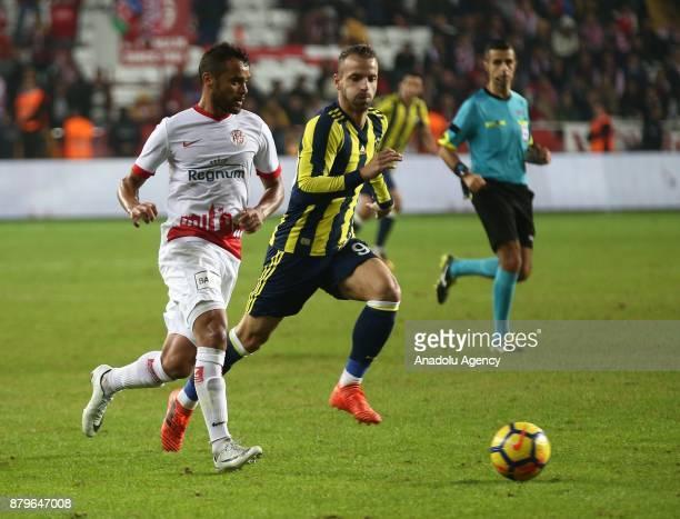 Saldado of Fenerbahce in action against Charles of Antalyaspor during the Turkish Super Lig match between Antalyaspor and Fenerbahce at Antalya...