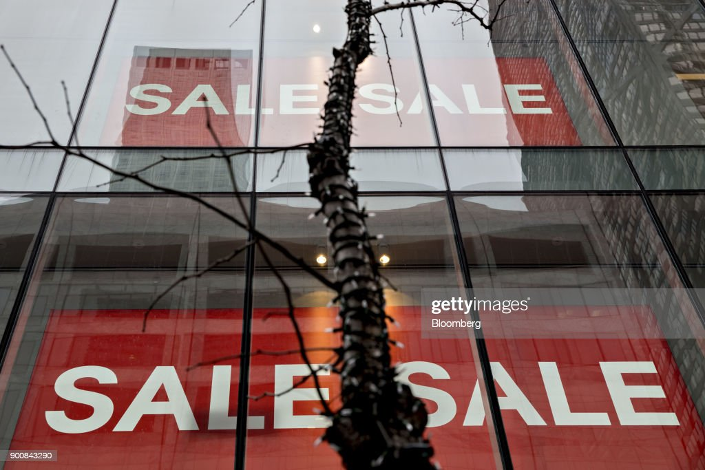 A 'Sale' is displayed in the window of a store at the Magnificent Mile commercial district in Chicago, Illinois, U.S., on Friday, Dec. 29, 2017. Bloomberg is scheduled to release consumer comfort figures on January 4. Photographer: Daniel Acker/Bloomberg via Getty Images